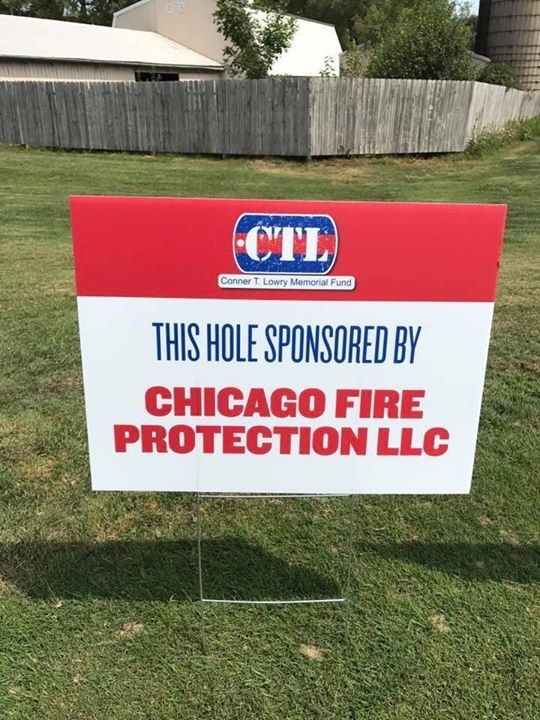 Sign at golf outing announcing a hole sponsored by Chicago Fire Protection in support of the Connor T. Lowry foundation